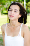 Relaxing Asian woman in the park Stock Image