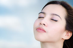 Relaxing asian woman with sky background Royalty Free Stock Images