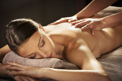 Relaxing back massage at spa Stock Photo