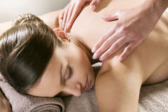 Relaxing back massage at spa Royalty Free Stock Photos