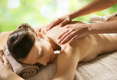 Relaxing back massage at spa Royalty Free Stock Image
