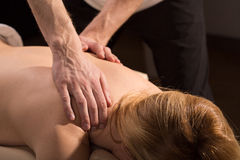 Relaxing back massage Stock Images