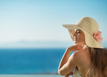 Relaxing on balcony on vacation woman Royalty Free Stock Photography