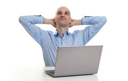 Relaxing bald man with laptop computer Stock Image