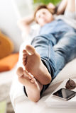 Relaxing barefoot Stock Images