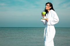 Relaxing bath robe woman Stock Image