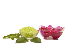 Relaxing bath. Bath salt with rose petals  on a white background Stock Photos