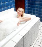 Relaxing Bath Woman. A woman soaking in a relaxing bath in an old style spa Royalty Free Stock Images