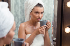 Relaxing in the bathroom. Young attractive woman relaxing in the bathroom stock photo