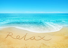 Relaxing Beach. Relax written in the sand Stock Photography