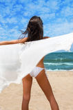 Relaxing at the Beach. Beautiful young woman relaxing on the beach stock photo