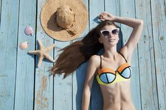 Relaxing on the beach. Relaxing attractive woman on the beach Stock Photo