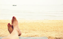 Relaxing on beach with bare feet Royalty Free Stock Photos
