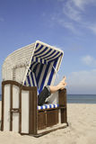 Relaxing in a beach chair Royalty Free Stock Images