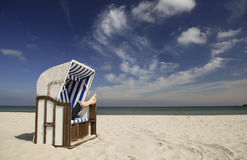 Relaxing in a beach chair by the sea Royalty Free Stock Images