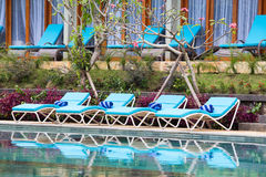Relaxing beach chairs and swimming pool Stock Photo