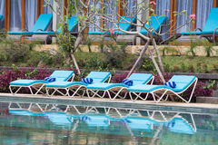 Relaxing beach chairs and swimming pool Royalty Free Stock Photos