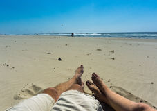 Relaxing at the beach - couple shot Royalty Free Stock Photos