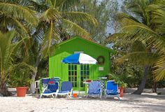 Relaxing beach escape in small green bungalow. Privacy and enjoyment in exotic Caribbean location stock images