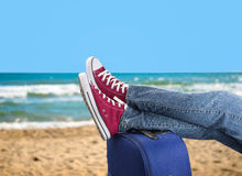Relaxing on the beach with my suitcase Stock Photo