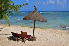 Relaxing on beach paradise with tree and hut shade with clear water Royalty Free Stock Photo