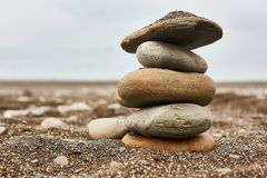 Relaxing on the beach, stack of stones royalty free stock photography