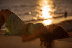 Relaxing at the beach during sunset Royalty Free Stock Photography
