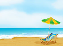 A relaxing beach with an umbrella and a foldable bed Royalty Free Stock Photography