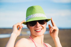 Relaxing beach woman enjoying the summer sun. Relaxing beach woman enjoying the summer sun happy in a wide sun hat at the beach with face raised to the sunlight Royalty Free Stock Images