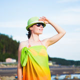 Relaxing beach woman enjoying the summer sun. Relaxing beach woman enjoying the summer sun happy in a wide sun hat at the beach with face raised to the sunlight Royalty Free Stock Image