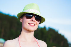 Relaxing beach woman enjoying the summer sun. Relaxing beach woman enjoying the summer sun happy in a wide sun hat at the beach with face raised to the sunlight Stock Photography
