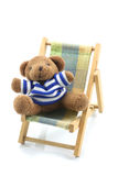 Relaxing bear on beach Bed Royalty Free Stock Photo