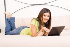 Relaxing on bed Royalty Free Stock Image