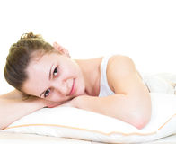 Relaxing in the bed. Young girl is relaxing in the bed. Isolated royalty free stock photo