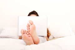 Relaxing in the bed Stock Images