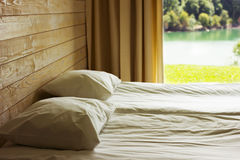 Relaxing bedroom with huge window Royalty Free Stock Photos