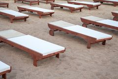 A relaxing beds fix in the sand. A flat structure filled with comfy fabric attracting tourist for body massage. Wellness therapy i stock photos