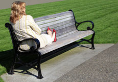 Relaxing on a bench. Stock Photos