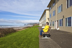 Relaxing on a bench with a view Oregon coast. Royalty Free Stock Photography