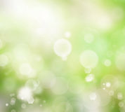 Relaxing blurred green glowy background. With light bubbles Royalty Free Stock Photos
