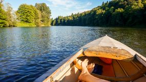 Relaxing in a boat on a river stock photo
