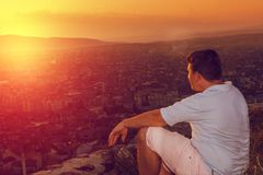 Relaxing boy looking to the city Stock Images