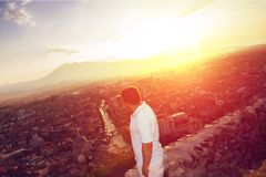 Relaxing boy looking to the city Royalty Free Stock Photography