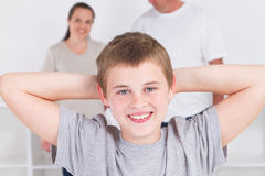 Relaxing boy with parents Royalty Free Stock Image