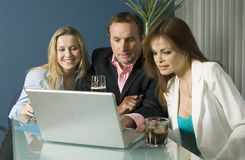 Relaxing break. Enthusiastic business team watching something relaxing on a laptop during a break Stock Image