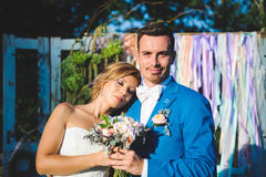 Relaxing Bride and Groom with Bouquet. Bride with closed eyes and groom with bouquet Stock Photo