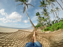 Relaxing on a Brown Knitted Hammock Royalty Free Stock Photo