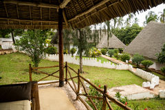 Relaxing in bungalow resort Zanzibar. Holiday resort in Africa on an exotic island Royalty Free Stock Image