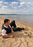 Relaxing businessman. Businessman relaxing on summer beach Royalty Free Stock Photography