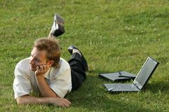 Relaxing businessman on the grass Stock Photography